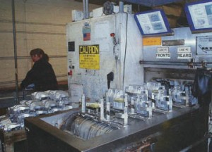 Brake parts are sent through a washing station before they are given a black oxide coating.